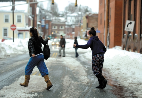 Pedestrians navigate the road along Franklin Street in downtown Norwich Monday.