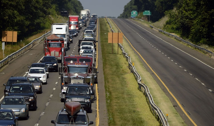 Northbound traffic slows to a crawl as it approaches the scene on I95 southbound in Old Lyme after a fire in a tractor trailer shut down the highway in the early morning hours Friday, July 19, 2013.