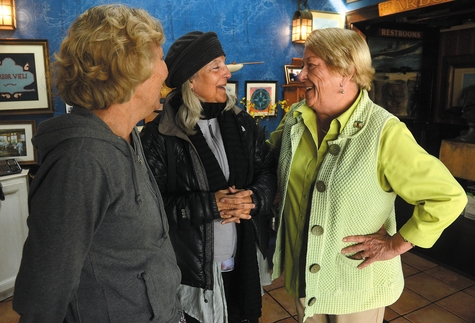 Ainslie Turner, right, owner of Skipper's Dock restaurant in Stonington borough, talks to longtime customer Paula Heckman and Heckman's friend Meg Mitchell, both of Branford, Monday at the restaurant. Skipper's Dock will be closing at the end of the month.