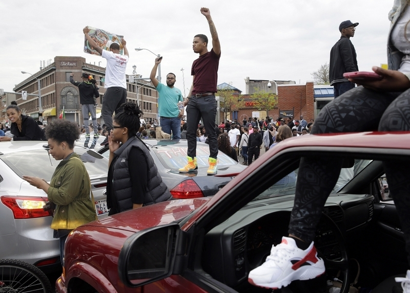 Baltimore celebrates charges against six officers