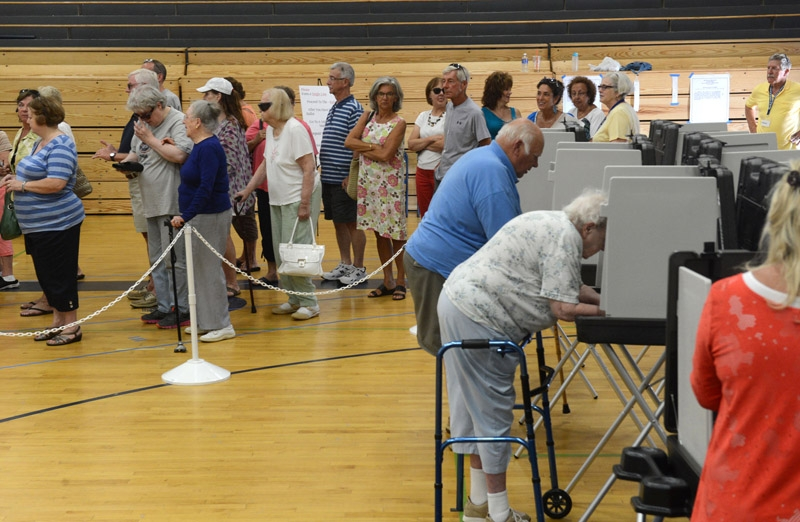People vote at the polling station at Old Saybrook High School Tuesday, July 8, 2014, on the town of Old Saybrook appropriating $3 million toward the purchase of nearly 1,000 acres of the coastal forest called The Preserve.