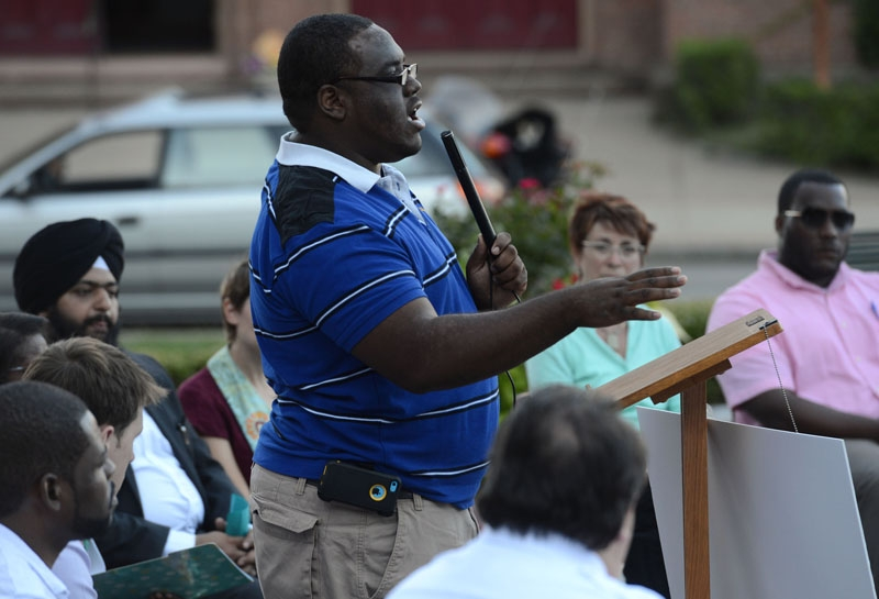 Derrell Wilson, president of CT State NAACP Youth and College Division, speaks during the vigil and rally in support of justice for Michael Brown Jr. in the courtyard at Norwich City Hall Friday, Aug. 29, 2014.