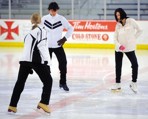 Former Olympic figure skaters Stephane Lambiel and Shizuka Arakawa, right, work out with artistic director Lea Ann Miller at the Municipal Ice Rink in Norwich on Monday. Lambiel, the 2006 men's silver medalist, and Arakawa, the 2006 women's gold medalist, are among 10 skaters who will perform in the 'Thin Ice' competition at MGM Grand at Foxwoods that will be aired live on ABC on Friday and Sunday.