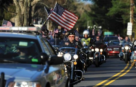 Motorcyclists ride amid the funeral procession for Tyler O. Griffin on Route 165 in Voluntown on Monday.