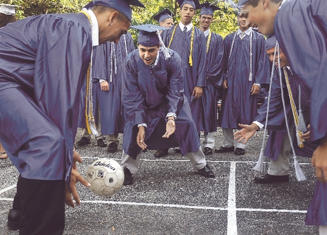 From left, Casey Brett, Jon Pope, Robert Tyler and Jake Monano play a game of 4 square Tuesday while waiting to line up for the processional prior to the Lyme-Old Lyme High School graduation ceremony.