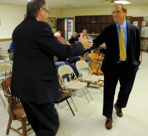 Republican challenger Stuart Norman, right, greets incumbent state Sen. Andrew Maynard, D-18th, upon his arrival at the Ekonk Grange in Sterling for a public forum on Wednesday.