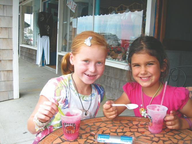 Ellen Naughton and Lucia Krekorian enjoy a Del's during their family reunion week in Watch Hill.