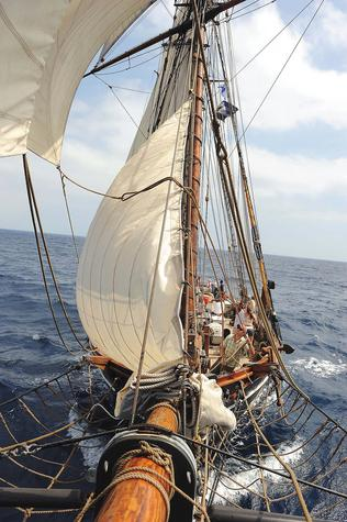 The crew of the Amistad raises the staysail in Cuba in March 2010.