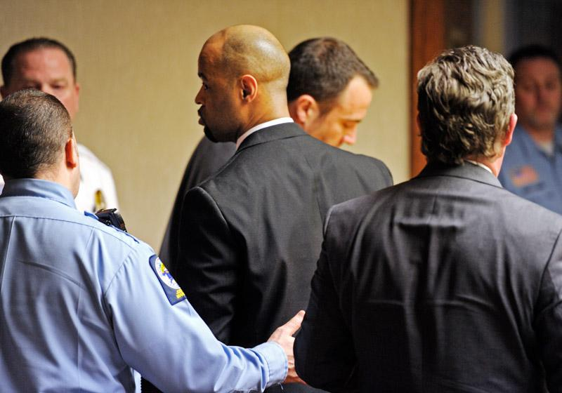 Dickie Anderson, Jr, center, is led from the court after the jury delivered a guilty verdict against him Wednesday, April 4, 2012, in Connecticut Superior Court in New London.