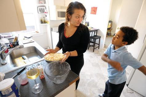 Kate Kennedy pals around at home with her son Calvin Kilgore, 7, as she prepares dinner at their apartment in New London.  Kennedy works three jobs, seven days a week to make ends meet.  She says Zane Megos owes her more than $7,000 for an apartment she never lived in.