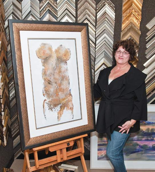 Denise Thompson, owner of Artisan Framing & Gallery in Niantic, displays one of her signature body prints at her Main Street shop.