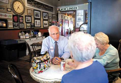 GOP U.S. Senate candidate Christropher Shays visits with Fran Kinsall, center, and Barbara Place at Muddy Waters in New London July 19, during a campaign swing through southeastern Connecticut.