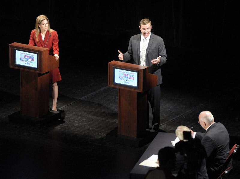 U.S. Congressman Chris Murphy, right, makes a point as he and former Secretary of the State Susan Bysiewicz debate for the final time Monday, July 30, 2012, at the Garde Arts Center in New London before the Democratic U.S. Senate primary  August 14th.