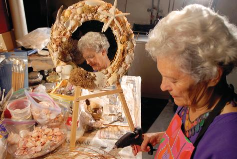 Kathleen O'Beirne of Mystic  works on ideas for her books and also creates wreaths from the stones, shells and other bits and pieces she found on the beaches she explores.