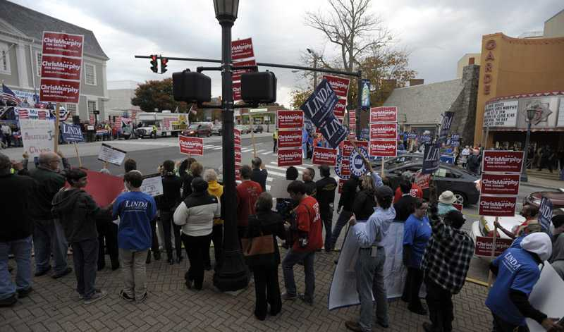 Supporters for both candidates rally outside the Garde Arts Center prior to the beginning of  a  U.S. Senate debate between Republican Linda McMahon and her Democratic opponent U.S. Rep. Chris Murphy at the Garde Arts Center in New London Monday, Oct. 15, 2012.