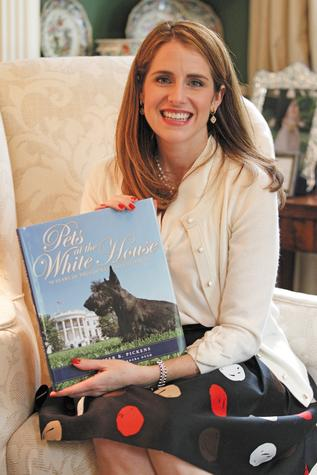 Jennifer B. Pickens with her book, 'Pets at the White House,' at her home in Dallas.