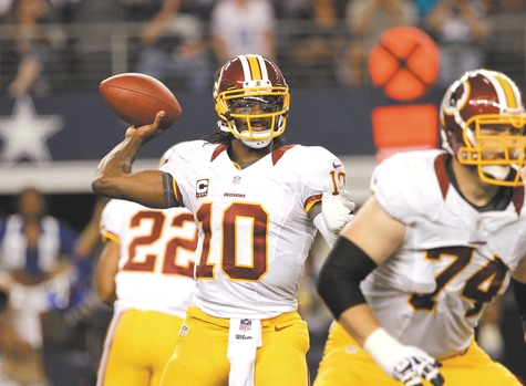 Redskins quarterback Robert Griffin III throws a pass during the second half of Thursday's game against the Cowboys at Arlington, Texas. The Redskins won 38-31.