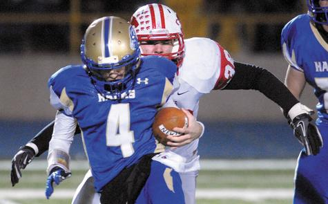 NFA's Steven Makowicki prepares to put a hit on Newtown quarterback Andrew Tarantino for a sack during the third quarter of Wednesday's Class LL quarterfinal victory over Newtown. NFA remained unbeaten at 11-0.