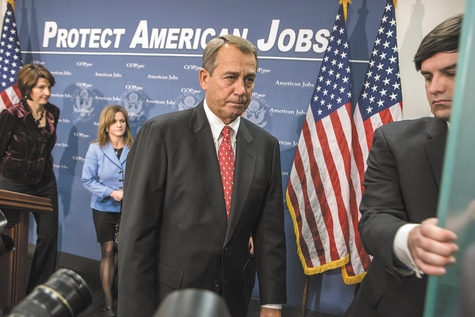 "House Speaker John Boehner, R-Ohio, left, speaks during a news conference Tuesday at the U.S. Capitol in Washington. Boehner discussed a backup bill to avoid the ""fiscal cliff"" a day after President Barack Obama delivered an offer in the negotiations."