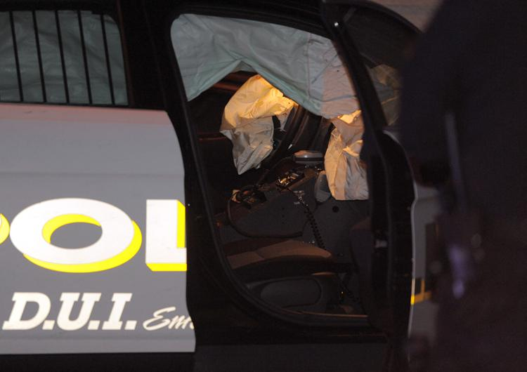 The interior of the injured officer's cruiser that was damaged during a car chase that ended at the intersection of Prospect Street and 10th Street in Norwichs late Thursday evening, Jan. 10, 2013.  The police officer sustained a head injury and was transported to the William W. Backus Hospital.