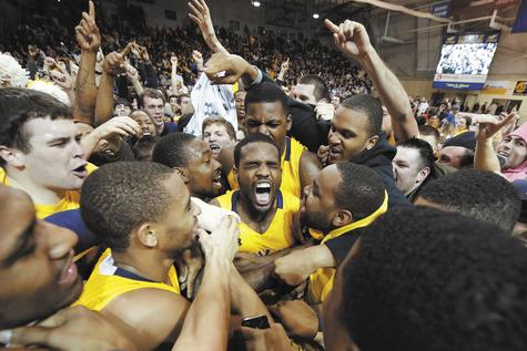 Ramon Galloway of La Salle, center, is mobbed by teammates and fans after making the game-winning basket in Wednesday night's 54-53 win over No. 9 Butler at Philadelphia.