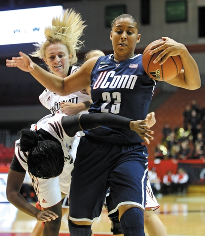 UConn's Kaleena Mosqueda-Lewis (23) pulls a rebound away from Cincinnati's Dayeesha Hollins during the first half Saturday. The No. 3 Huskies rolled to a 67-31 Big East win over the Bearcats.