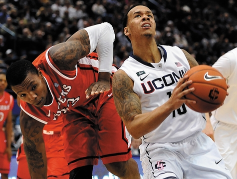 Shabazz Napier of UConn drives past Wally Judge of Rutgers on the way to the basket in the second half of Sunday's Big East Conference game at the XL Center in Hartford. Napier scored 19 points as UConn won 66-54.