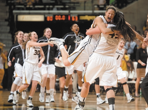 Liz Smith of Missouri, right, is hugged by teammate Liene Priede as the rest of the team storms the court after beating No. 9 Tennessee 80-63 Sunday afternoon at Columbia, Mo. It was Missouri's first win over a ranked team in almost two years.