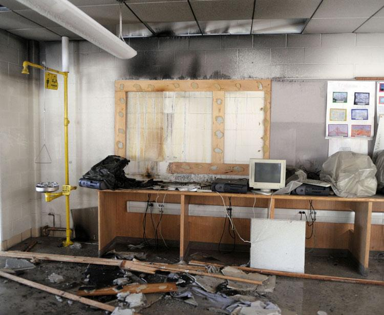 A melted computer, at left end of counter, sits in the classroom where it caught fire in the early hours of Monday morning March 4, 2013 at Kelly Middle School in Norwich. Damage to the 7th-8th grade wing of the school was extensive enough to force the closing of the building.