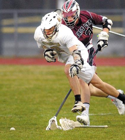 Stonington's Dan Riordan, left, loses his stick as he pursues a loose ball with East Lyme's Brandon Page during Thursday's boys' lacrosse game in Stonington. The Bears beat the Vikings 7-6.