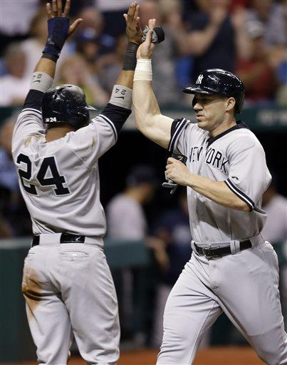 New York's Robinson Cano (24) and Travis Hafner celebrate after scoring on Ichiro Suzuki's two-run, ninth-inning single off Tampa Bay's Fernando Rodney during Tuesday's game in St. Petersburg, Fla. The Yankees won, 4-3.