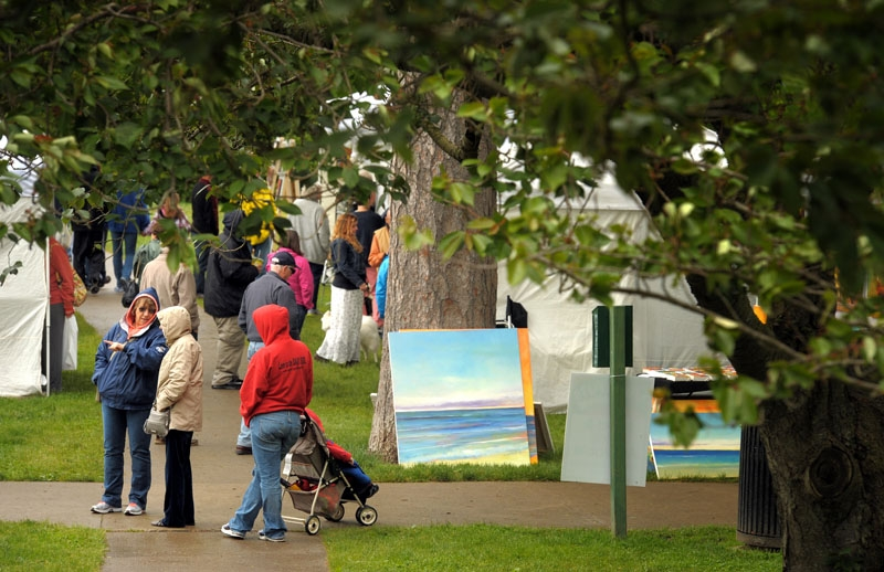 Art lovers from around the region brave the cold and rain to attend the 16th annual Virtu Art Festival in Wilcox Park in Westerly Saturday, May 25, 2013.