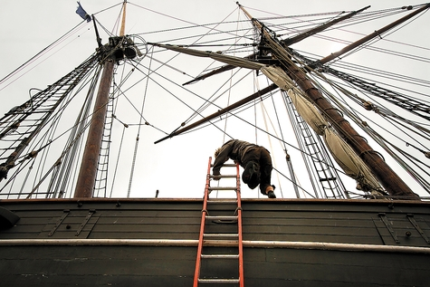 A crew member climbs aboard the Amistad on Thursday as the replica of the infamous one-time slave-carrying vessel undergoes maintenance in Portland, Maine.