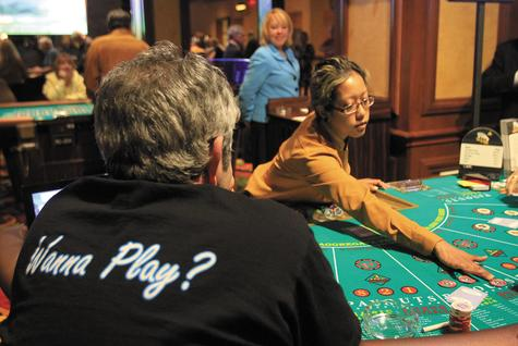Twin River dealer Vanna Phan of Providence deals at the 'Let It Ride' poker game Tuesday as part of a test run for today's official opening.