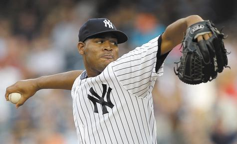 New York pitcher Ivan Nova delivers in the first inning against Kansas City on Wednesday at Yankee Stadium. Nova allowed five hits and an earned run over eight innings and struck out six as the Yankees won, 8-1.