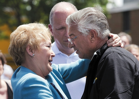 Raymond Lafontaine, who lost his son and two daughters-in-law, receives a hug from Quebec Premier Pauline Marois during her visit to Lac-Megantic, Quebec, Thursday. Marois toured the site of Canada's worst railway catastrophe in almost 150 years, after a runaway oil train killed 50 people in a fiery explosion.