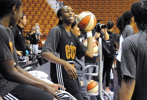 Connecticut's Allison Hightower laughs with her Eastern Conference teammates while waiting for practice to begin on Friday at Mohegan Sun Arena. Hightower, in her fourth season, makes her debut today when the Sun host the WNBA All-Star Game.