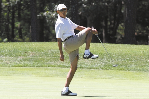 President Barack Obama reacts as he misses a shot while golfing Sunday on the first hole at Farm Neck Golf Club in Oak Bluffs, Mass., on the island of Martha's Vineyard.