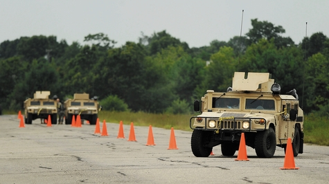 A driver takes a HMMWV through the slalom course Monday as Army National Guard and Army Reserve Military Police undergo training with the 3rd Battalion 169th Regiment of the Connecticut Army National Guard at Stones Ranch Military Reservation in East Lyme.