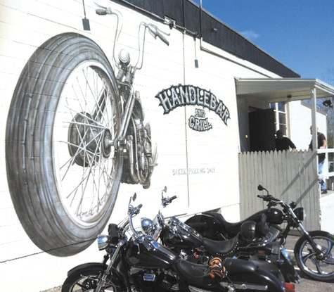 Stonington has sued the owner of the Handlebar Cafe over the legality of a new, large mural on the side of business and a pair of handlebars overhanging its roof, both added as part of the filming of a television reality show.