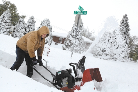 Don Stritecky clears the sidewalk in front of his home with a snow blower in Rapid City, S.D., Saturday. South Dakota emergency agencies are asking snowmobile operators in the Rapid City area to help find motorists stranded by an autumn storm. The National Weather Service says the storm dumped at least 3� feet of wet, heavy snow in the Black Hills. Rapid City had 21 inches, but 31 inches was recorded just a mile southwest of the city.