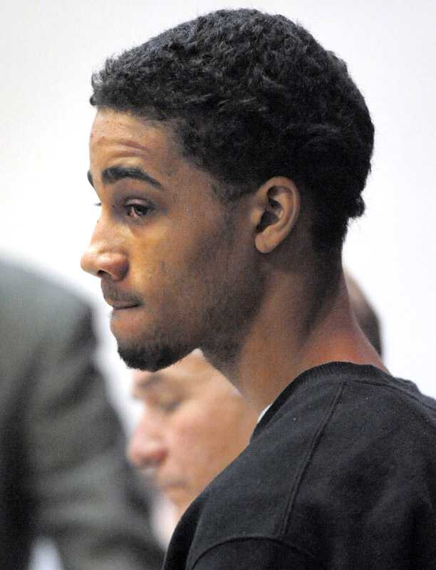 In this Nov. 14, 2011, Day file photo, Evan Holmes is arraigned in Superior Court in New London on charges stemming from the murder of Jorge Rosa on Saturday. On Tuesday, Oct. 8, 2013, Holmes was found guilty of felony murder, manslaughter and home invasion.
