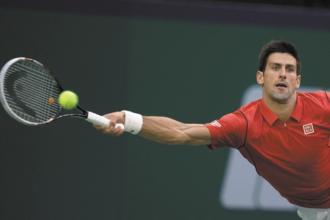 Novak Djokovic returns a shot to Juan Martin del Potro during the Shanghai Masters final Sunday.