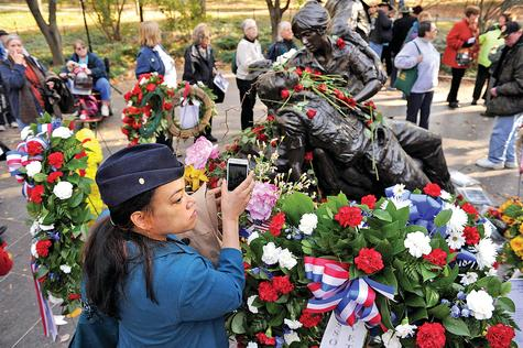 Geniece Elejalde takes a photo of the Vietnam Women's Memorial in Washington during a ceremony to honor the 20th anniversary of the memorial last week.