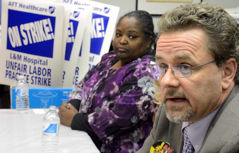 American Federation of Teachers Field Representative Greg Kotecki, right, speaks during a press conference while AFT CT 5051 President Stephanie Johnson, center, listens Tuesday, Nov. 26, 2013, about a pending strike by AFT CT Local 5049 of Registered Nurses and AFT CT Local 5051 of LPN Technologists after talks between the unions and L+M Hospital broke down.
