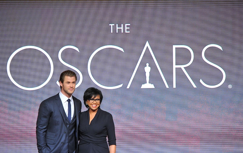 Chris Hemsworth, left, and President of the Academy Cheryl Boone Isaacs pose at the 86th Academy Awards nomination ceremony on Thursday, Jan. 16, 2013 in Beverly Hills, Calif. The 86th Annual Academy Awards will take place on Sunday, March 2,  at the Dolby Theatre in Los Angeles.