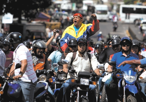 Aury Carrasquel, leader of a group of motorcyclists, shouts slogans against a proposed nighttime curfew for two-wheelers in Caracas, Venezuela, on Friday. President Nicolas Maduro's government has lent its support to proposals to ban motorcycles from circulating at night, arguing that the vehicles are used to carry out murders and kidnappings that have proliferated recently.