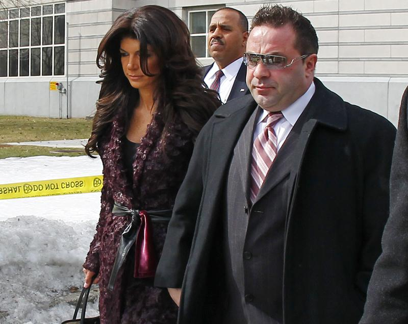 "Teresa, left, and Joe Giudice, from ""The Real Housewives of New Jersey,"" leave federal court Tuesday in Newark, N.J. They each pleaded guilty to several counts including bankruptcy fraud, conspiracy to commit mail fraud and wire fraud, and failing to pay taxes."