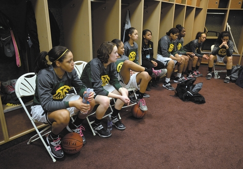 The New London girls' basketball team gets prepared in their locker room before Sunday's CIAC Class M championship victory at Mohegan Sun Arena.