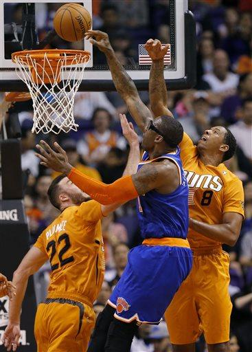 New York's Amare Stoudemire misses a dunk as Phoenix's Miles Plumlee (22) and Channing Frye (8) defend during the second half of Friday's game in Phoenix. The Suns won 112-88.